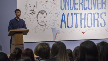 Norwich-based performance poet Cai Draper speaks at the Undercover Readers celebration event at the