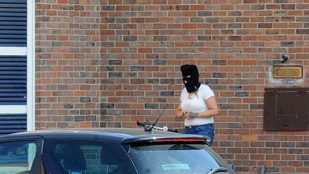 Zoe Rushmer wearing a balaclava at Norwich Crown Court. Picture: Archant