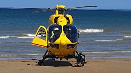 HM Coastguard Bacton called the East Anglian Air Ambulance after a woman became ill on Happisburgh b