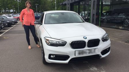 Katie Hope, who was jailed for an online nutrition scam, posing with one of the cars bought during t
