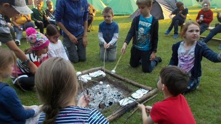 Years 3 and 4 at Ludham Primary School had a great time pitching tents and toasting marshmallows ove
