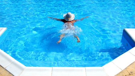 Skinny dipping in a swimming pool Credit: Getty Images/iStockphoto