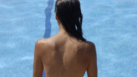 A woman enjoying a summer day skinny dipping. Photo: Getty Images/iStockphoto