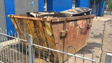 Skip next to The ONE80 community centre in Norwich where there was a fire. PIC: Peter Walsh.