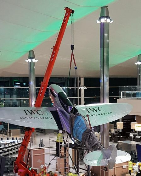 The replica spitfire was craned into position at Heathrow with minutes to spare. Pic: submitted