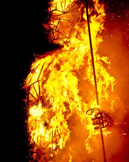 The Pakefield man sculpture at First Light Festival goes up in flames. Credit: Gareth Pepperell