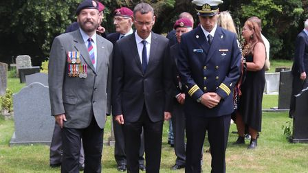 Israeli ambassador to the UK Mark Regev (centre) was among those to pay tribute to Norfolk soldier T