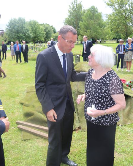 Israeli ambassador to the UK Mark Regev speaks to Irene Bowden at Diss Cemetery. Picture: Stan Kaye