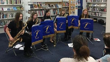 Kaira Bundock, Holly Potter, Holly Wilson and Georgina Frary perform in the town library PICTURE: Co