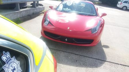 A Ferrari with no number plate was stopped by police. PIC: Norfolk & Suffolk Roads and Armed Policin