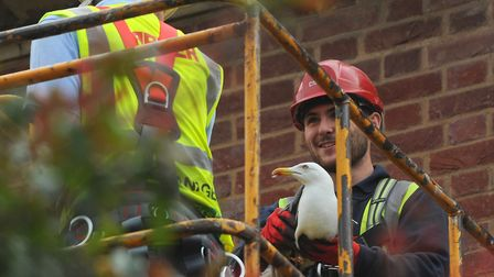 Workers from Carter builders, Ben Culyer, left, site manager, and Billy Bales, use a cherry picker t