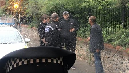Police surround a man who has approached an undercover female officer on Rosary Road. Photo: Bethany
