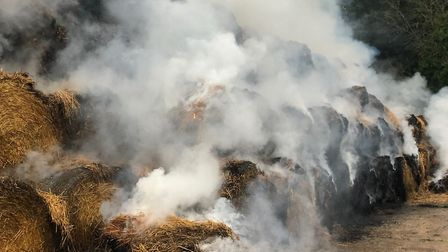 Fire crews tackled a large straw stack fire at a farm in Felmingham. Picture: Kit Papworth
