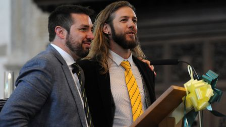 James and Robert Blower singing On The Ball, City' at the celebration of life service for Roy Blower