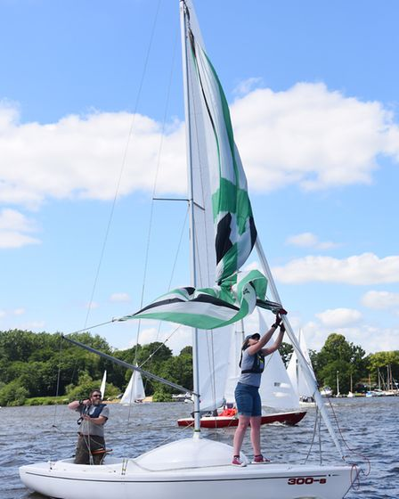 The colourful spinnaker on this Yeoman gets tangled during one of the national championship races at