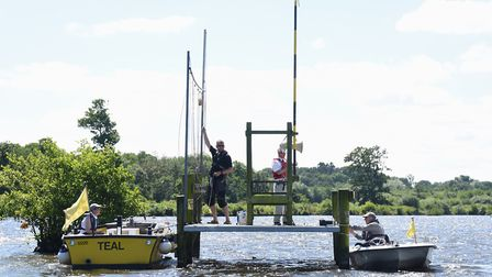 Members of the Norfolk Broads Yacht Club set up the start for the Yeoman national championship races