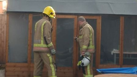 Firefighters checking a smoke filled summer house on Appleyard Crescent in Hellesdon. Photo: Submitt