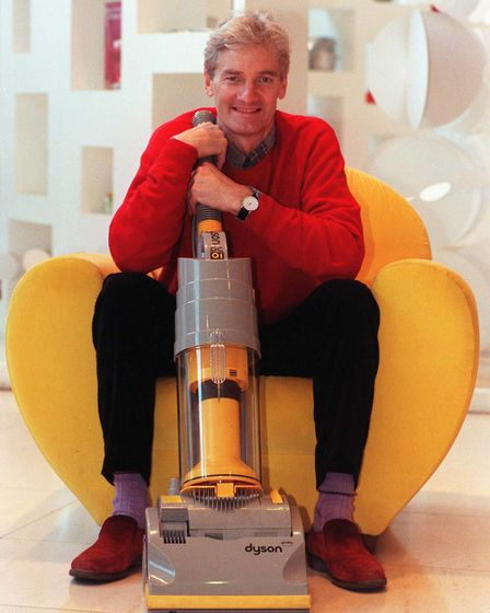 Sir James Dyson with one of his groundbreaking vacuum cleaners. Picture: PA/Fiona Hanson.