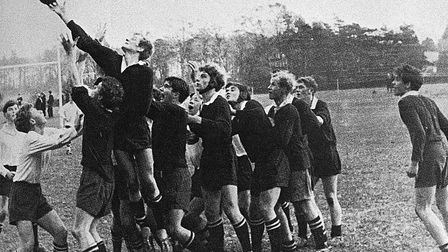 James Dyson reaches for the ball during a game of rugby at Gresham's School in 1965. Picture: Gresha
