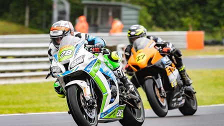 Tim Neave leads Bjorn Estment at Brands Hatch - but it was Estment at the flag Picture: Barry Clay