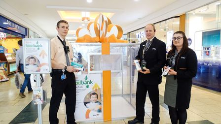 The intu Chapelfield team donate the first items to the Norwich Foodbank donation station in the sho