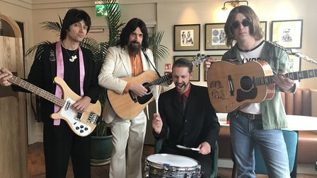 """The Beatles tribute band Let It Be playing """"Get Back"""" at the Theatre's Prelude restaurant. From left"""