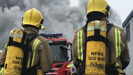 Firefighters with breathing apparatus tackle a blaze at Rackheath Industrial Estate. An inspector ha