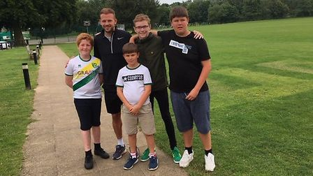 Former Norwich City footballer Jordan Rhodes with youngsters from the Costessey Youth Posse at the C