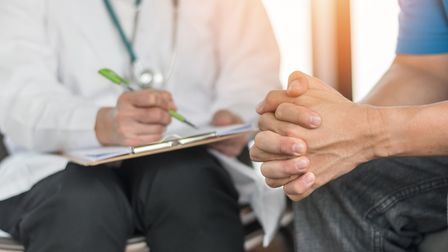 Stock photo of a doctor with a patient. Photo: Getty