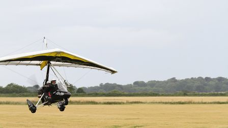 Student Hannah Lev, 14, in the weightshift microlight at Northrepps Aerodrome with pilot Kevin Smith