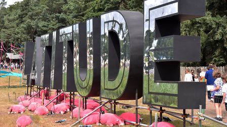 The famous pink sheep finding shade under the Latitude sign, Latitude 2019. Picture: Jamie Honeywood
