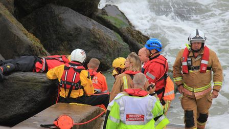 Emergency services working to free a man stuck in rocks on Sheringham seafront. Picture: KAREN BETHE