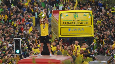 Norwich City footballers celebrate going up to the Premier League on the parade bus. Picture: DENISE