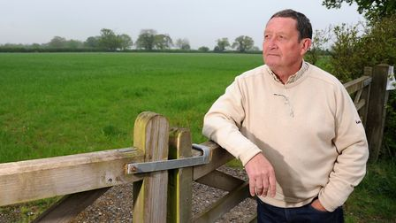 Mulbarton Parish Council Chairman Peter Leigh looks over the fields where 180 homes are to be built.