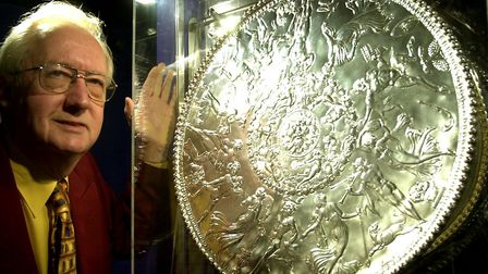 Dr Colin Dring in 2002 with the replica of the Great Dish at Mildenhall Museum Picture: ANDY ABBOTT