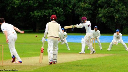Lewis Denmark on the attack for Swardeston before their reply against Cambridge was cut short by rai