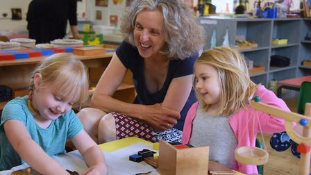 Sarah Johnson, manager of the Norwich Montessori School at Colney, with four-year-olds Florence Smit