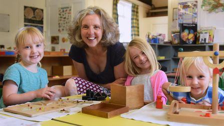 Sarah Johnson, manager of the Norwich Montessori School at Colney, with four-year-olds from left, Fl