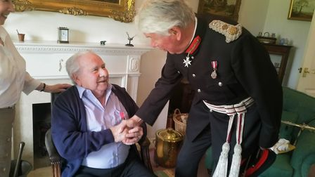 John Newstead was presented with a British Empire Medal by the Lord Lieutenant of Norfolk Richard Je