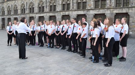 During the wreath laying ceremony, the choir of 40 students and staff sang 'Abide With Me' and the a