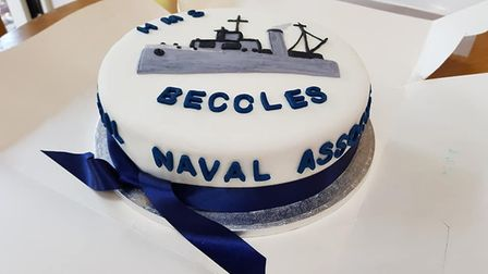 """Jesse Webb was presented with a """"wonderful"""" birthday cake depicting HMS Beccles. Picture: Andy Osbou"""