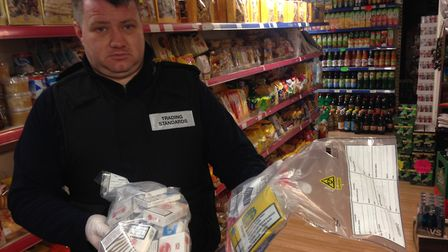 Stephen Maunder, community protection officer with trading standards, with the goods found inside Ku