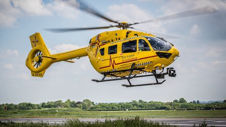 The air ambulance landed at Fiveways roundabout on the A11. Photo: Perfect Pose Photography/EAAA