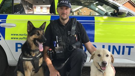 Police dog handler Jamie Ward with Neeko and Toby. Picture: Victoria Pertusa