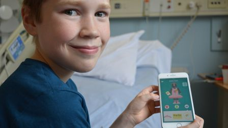 Joseph Howard testing out the Little Journey app. Photo: NNUH
