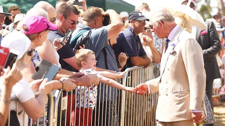 HRH The Prince of Wales shares a nice moment with a young visitor to the show. Picture: Ian Burt