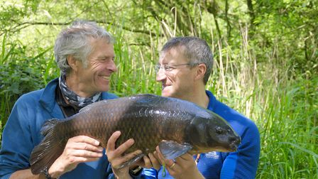 JB and JG congratulate each other on catching the same carp the same way in the same session! Pictur