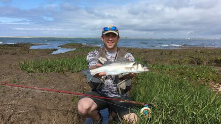 George Downing with his fabulous creek caught bass Picture: John Bailey