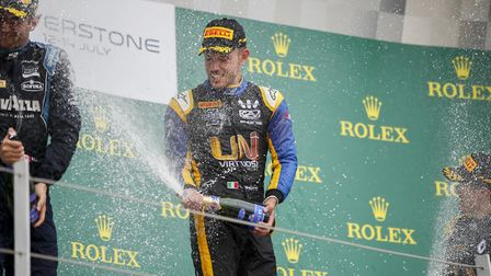 Luca Ghiotto celebrates on the podium his first Feature race win in the FIA Formula Two series at Si
