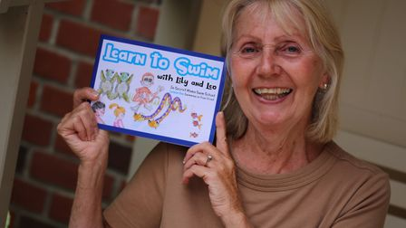 Maureen Bennett with a copy of her book, Learn to Swim with Lily and Leo Picture: JIM KEENAN
